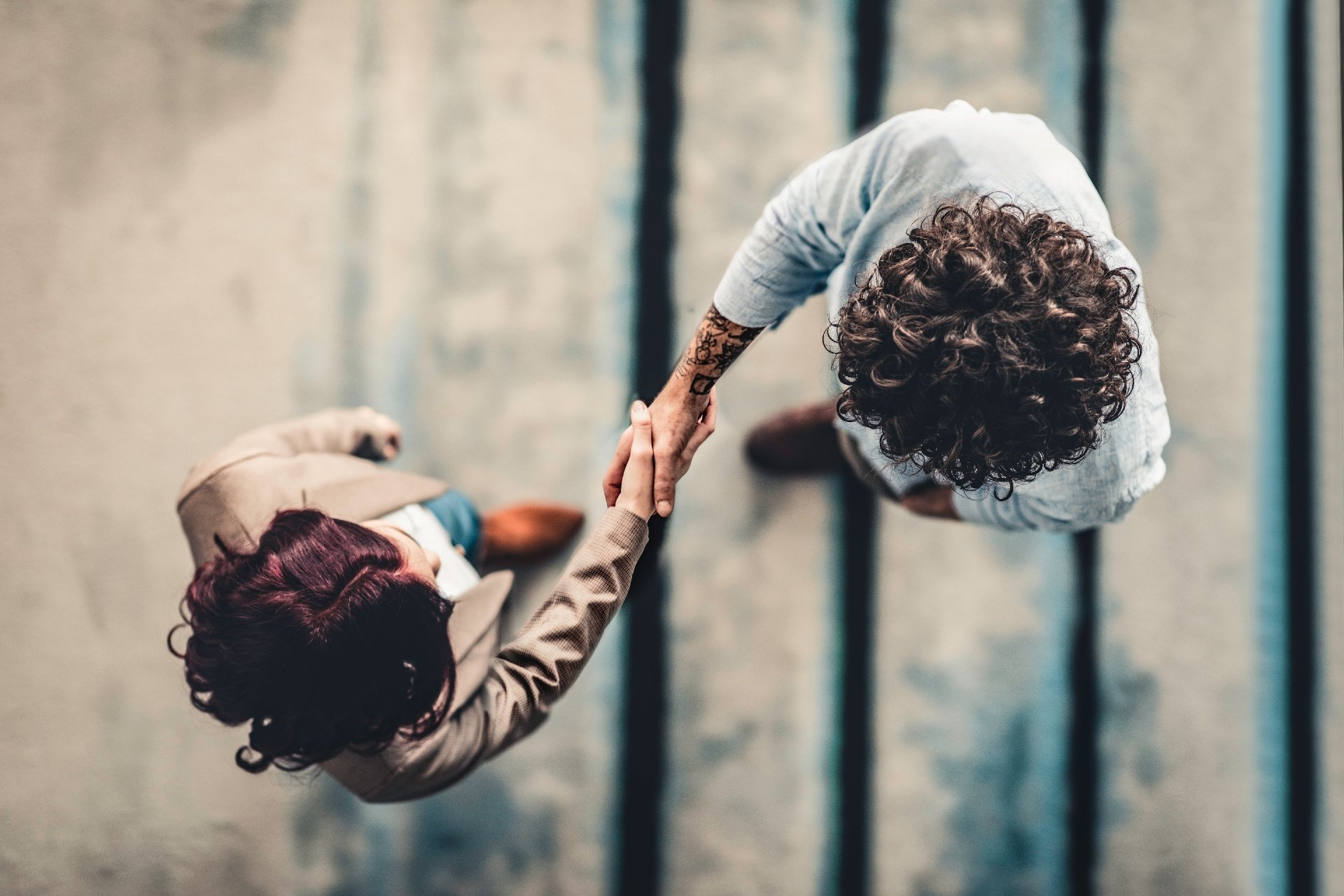 Man and woman shaking hands, aerial shot
