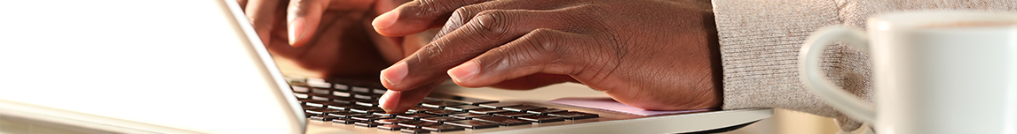 hands-typing-on-laptop