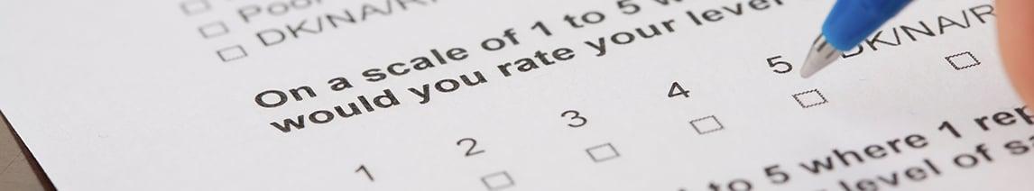 Pen-filling-out-survey