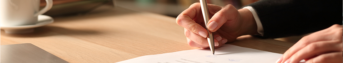 person-writes-on-paper-with-pen