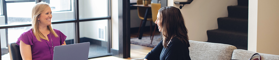 Two-women-have-conversation-in-office