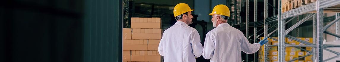 two-men-walk-through-warehouse