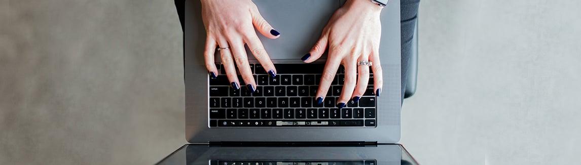 Woman-types-on-laptop-keyboard