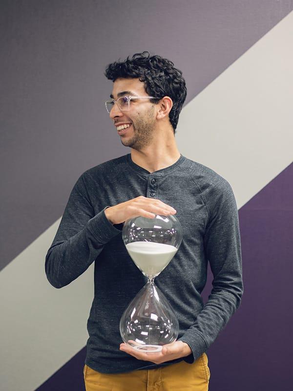 Jacob holding hour glass